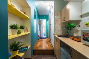 Кухня или мини-кухня в MWA Gromova