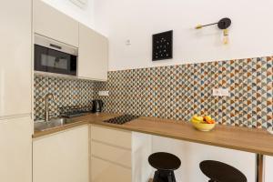 Kuchyň nebo kuchyňský kout v ubytování Royal Ferenciek Apartment