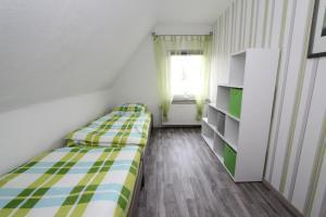 Ein Bett oder Betten in einem Zimmer der Unterkunft Ferienhaus Olenbrook
