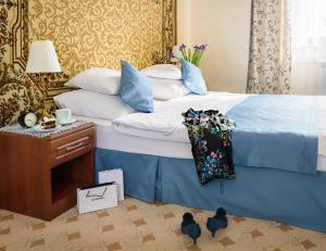Кровать или кровати в номере Тематическая гостиница Советская
