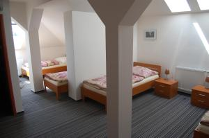 A bed or beds in a room at Penzion Jarka