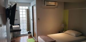 A bed or beds in a room at Playground Hostel