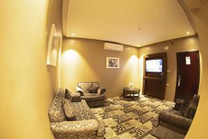 Uma área de estar em Restin Hotel