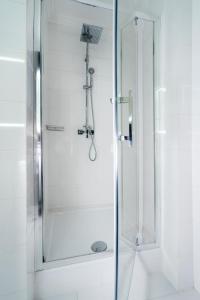 Ein Badezimmer in der Unterkunft Flatlux Apartments