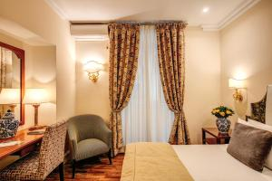 Cama ou camas em um quarto em Hotel Cortina