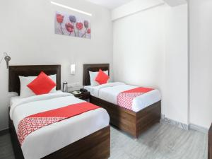 A bed or beds in a room at Hotel Lily Bay Prime