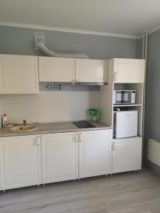 A kitchen or kitchenette at Уютная квартира
