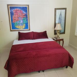 A bed or beds in a room at Orchid Cottage