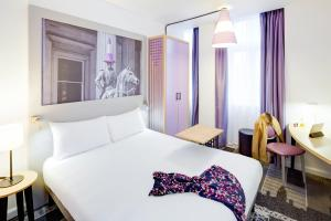 A bed or beds in a room at ibis Styles Glasgow Centre George Square