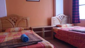 A bed or beds in a room at Caroline lodging