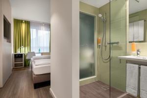 A bathroom at Super 8 by Wyndham Oberhausen am Centro