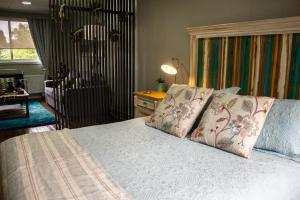 A bed or beds in a room at Tejas Del Sur