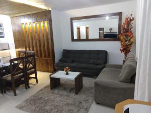 Uma área de estar em Apartamento Serra Bella - Canela RS