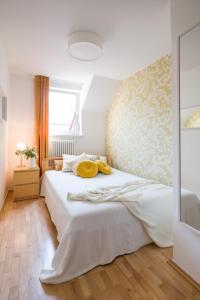 Łóżko lub łóżka w pokoju w obiekcie Kazimierz Apartment