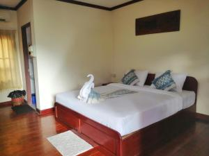 A bed or beds in a room at Phamarnview Guesthouse