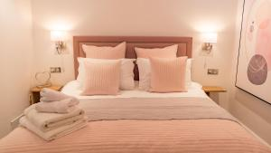 A bed or beds in a room at St Annes Beach Apartments