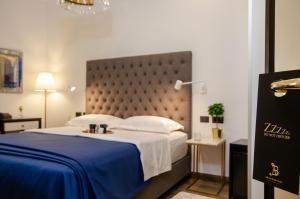 A bed or beds in a room at Villa Brandestini