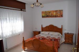 A bed or beds in a room at El Molino