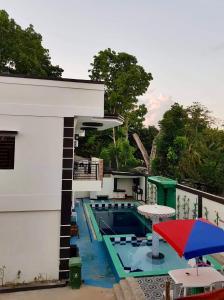 The swimming pool at or near JJJGM Place Palawan