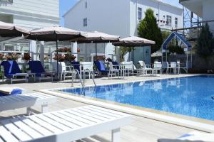 The swimming pool at or near Ascot Hotel Büyükada