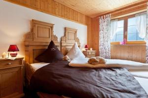Ein Bett oder Betten in einem Zimmer der Unterkunft Hotel Gasthaus Schäfle