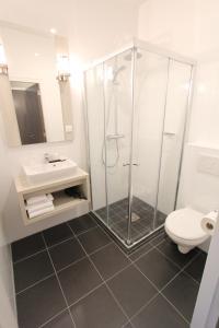 Ein Badezimmer in der Unterkunft Apple Inn Hotel