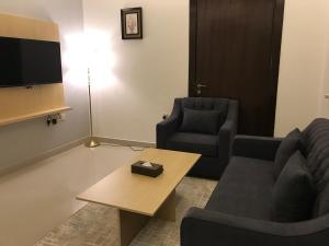 Uma área de estar em Asfar Hotel Suites