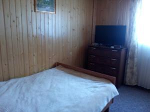 Кровать или кровати в номере Dom 144