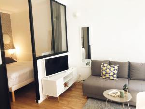 A seating area at Magnifique Appartement à 100 m de la Canebière