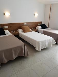 Cama o camas de una habitación en Hotel Ronsel