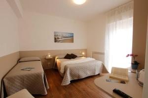 A bed or beds in a room at Affittacamere Sabri