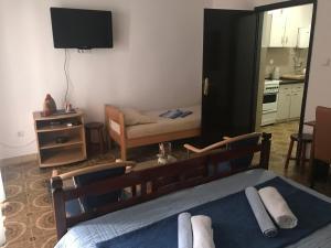 Телевизор и/или развлекательный центр в Apartmani Miron