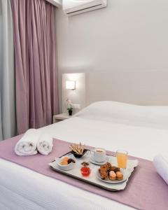 A bed or beds in a room at Poseidonio Hotel