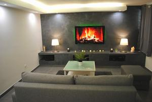 """A seating area at COSY & SPA Appartement luxe JACUZZI """"Suite Diamant"""""""