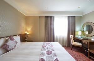 豐原五都大飯店房間的床