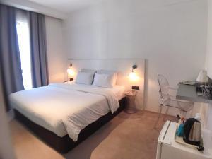 Ein Bett oder Betten in einem Zimmer der Unterkunft Melange Boutique Hotel Bukit Bintang