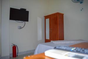 A television and/or entertainment center at Phong Nha Orient Hotel