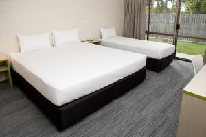 A bed or beds in a room at Kondari Hotel
