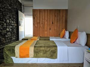 A bed or beds in a room at Gantavya Resort