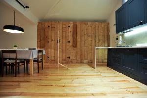 A cozinha ou kitchenette de GS Chiado Boutique Studios & Suites