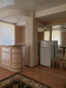 A kitchen or kitchenette at Afrodita Hotel