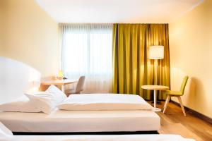 A bed or beds in a room at Select Hotel Erlangen