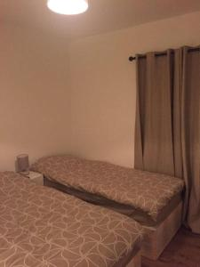 A bed or beds in a room at Lewisham