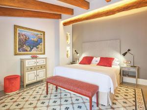 Säng eller sängar i ett rum på Hotel Gloria de Sant Jaume