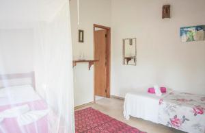 Cama ou camas em um quarto em Pousada Peki