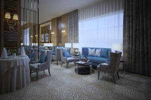 Uma área de estar em Lavona Tiba Hotel