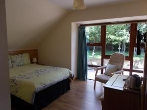 A bed or beds in a room at Forest View