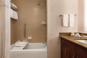 A bathroom at Homewood Suites by Hilton-Seattle Convention Center-Pike Street