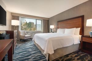 A bed or beds in a room at Homewood Suites by Hilton-Seattle Convention Center-Pike Street