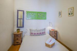 Un ou plusieurs lits dans un hébergement de l'établissement Botanico Hostel